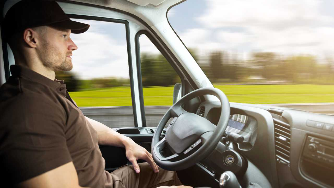 Delivery driver sitting inside self driving van