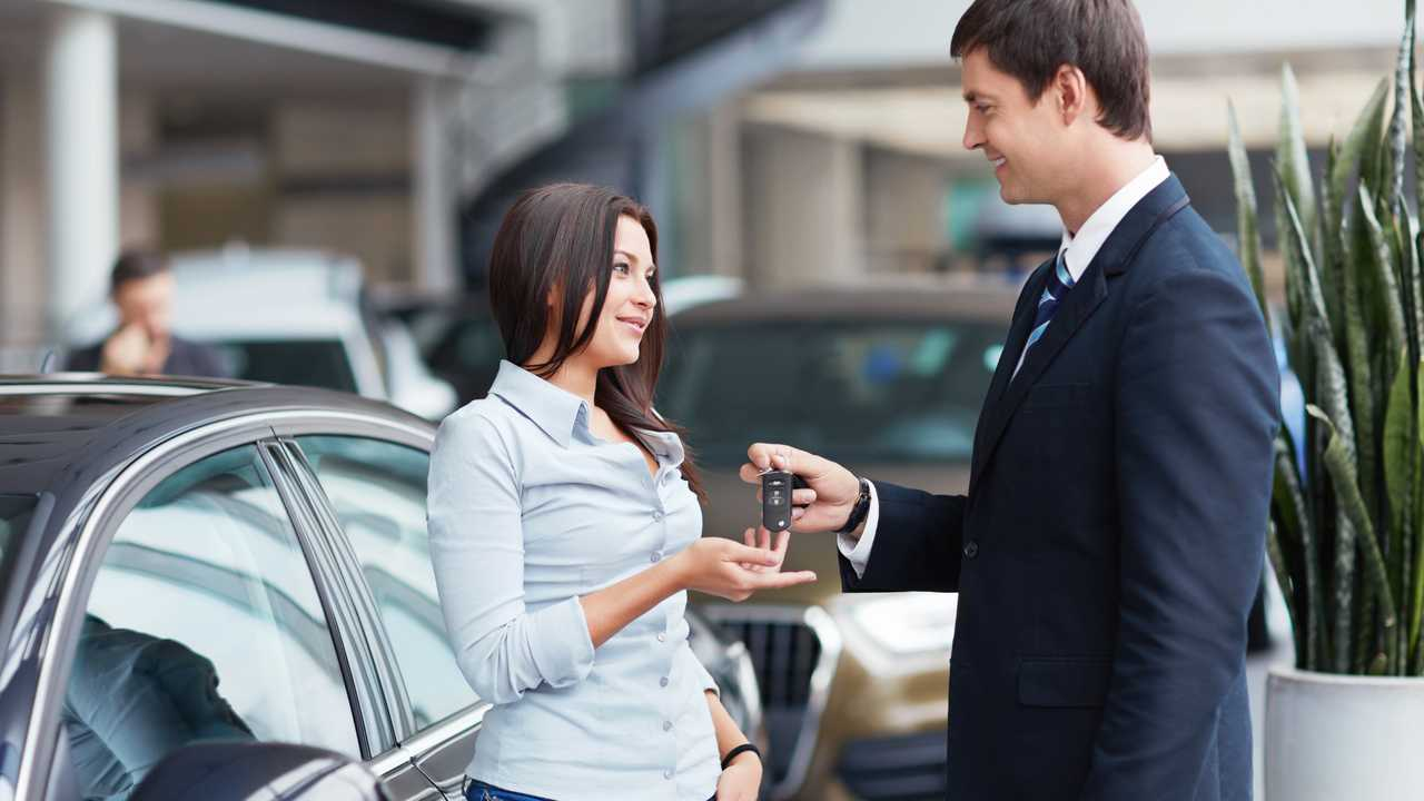 Young woman buys rents a car