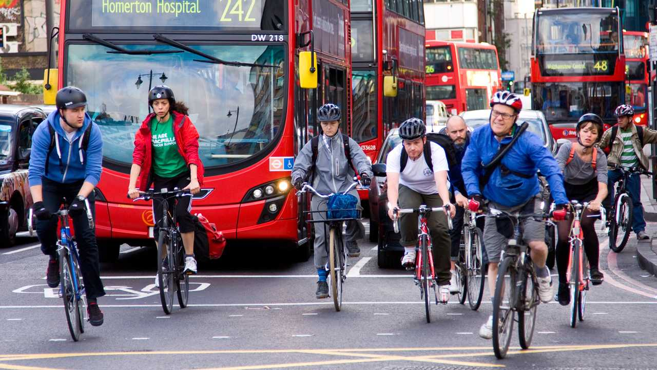 Cyclists commuting to work in London UK